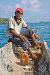 "Local Kuna man on a Cayuko ""dug-out canoe"" in the San Blas Islands, Kuna Yala, Panama"