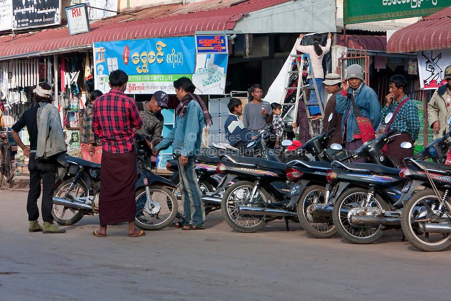 Myanmar, Burma.  Kalaw Street Scene.  Burmese Men Discussing their Motor Bikes.