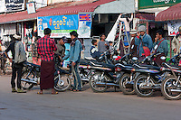 Myanmar, Burma.  Kalaw Street Scene.  Burmese Men Discussing their Motor Bikes.