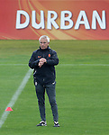 Netherland's coach Bert van Marwijk looks at his watch during a soccer training session in the Princess Magogo stadium in the township of Kwamashu in Durban June 27, 2010.REUTERS/Michael Kooren (SOUTH AFRICA) ...