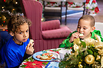 TORRINGTON, CT. 20 December 2019-122019BS13 - Tyler Perez, 9, left, and his brother Mason Perez, 7, enjoy some Christmas cookies while waiting for Santa to arrive, at the FISH of Northwestern Connecticut Homeless Shelter in Torrington on Friday. Bill Shettle Republican-American