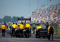 Aug 8, 2020; Clermont, Indiana, USA; Crew members push the dragster of NHRA top fuel driver Shawn Langdon during qualifying for the Indy Nationals at Lucas Oil Raceway. Mandatory Credit: Mark J. Rebilas-USA TODAY Sports
