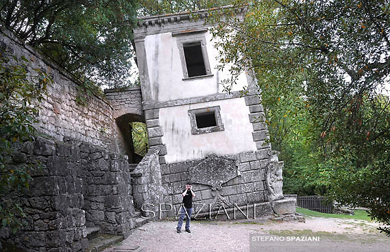 "The Hanging House.A house build on an inclined rock. According inside you have dizziness..The Park of the Monsters of Bomarzo.The Park of the Monsters  also named Sacred Wood is a Renaissance monumental complex located in Bomarzo, in the province of Viterbo, in northern Lazio, Italy.25 jun 2012..In the region of Lazio, the marvellous land of the Etruscans, the Romans and the Middle Ages, lies the village of Bomarzo which shares all the glory of the region's illustrious history and possesses an historical site which is the only one of its kind in the world: ""The Villa Of Marvels"". In the gardens of other villas in Lazio you will find certain similirities, but the prototype of all these gardens remains the ""Sacred Wood of Bomarzo"", that popular fancy rebaptized as Monster's Park. Prince Pier Francesco Orsini, known as Vicino, wanted such a park ""only to ease the heart"". It was designed and laid out by the great architect, Pirro Ligorio, who was summoned to work at Saint Peter's in Vaticano after the death of Michelangelo. Without either Prince Orsini or Ligorio ever realizing it, a timeless masterpiece was born. When you visit this park you will go from surprise to surprise as animals and figures in stone suddenly appear: the Elephant that is about to kill a Warrior, the fighting Dragons, the Ogre in whose mouth you could pic-nic, Sleeping Beauty, Hercules tearing Cacus apart, Bears in ambush, animals with three heads, Neptune presiding figures, and finally a globe of the world balanced on the head of an Orc with a model of the Orsini Castle on top representing the power of his family. These sculptures carred out of massive boulders in situ, appearing to rise up out of the very ground as if by magic. It all goes back to the 16th Century (1552), the period which saw the development of an ideal of life between Prince and Courtier. This wood has inspired many important artists and poets of the time such as Annibal Caro, Bitussi and Cardinal Madruzzo wanted to express the"