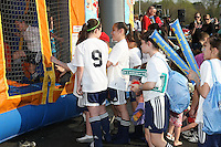 Young fans waiting for their turn on the moon bounce prior to the Philly home opener.  Philadelphia hosted the Atlanta Beat in the inaugural game for both teams at John A Farrell Stadium in West Chester, PA.  The game ended in a scoreless tie.