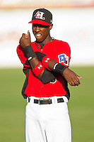Jurickson Profar #10 of the Hickory Crawdads stretches prior to the game against the Augusta GreenJackets at L.P. Frans Stadium on April 29, 2011 in Hickory, North Carolina.   Photo by Brian Westerholt / Four Seam Images