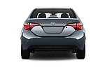 Straight rear view of a 2018 Toyota Corolla L 4 Door Sedan stock images