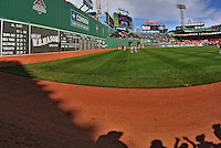 9 June 2012: View of Fenway Park's scoreboard, the Green Monster, with members of the Washington Nationals on the field prior to a game against the Boston Red Sox at Fenway Park in Boston, MA. The Nationals defeated the Red Sox 4-2 in the second game of their 3-game series. Mandatory Credit: Ed Wolfstein Photo