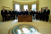 United States President George W. Bush poses for a photograph with present and former Secretaries of State and Defense in the Oval Office at the White House in Washington, DC on January 5, 2006. Bush met with the bipartisan group to discuss the war in Iraq. From left is former US Secretary of Defense Harold Brown, former US Secretary of State Lawrence Eagleburger, former US Secretary of State James A. Baker III, former US Secretary of State Colin Powell, former US Secretary of Defense James Schlesinger, US Secretary of Defense Donald Rumsfeld, US Vice President Dick Cheney, Bush, US Secretary of State Condoleezza Rice, former US Secretary of State George Schultz, former US Secretary of Defense Melvin Laird, former US Secretary of Defense Robert McNamara, former US Secretary of State Madeleine Albright, former US Secretary of State Alexander Haig, former US Secretary of Defense Frank Carlucci, former US Secretary of Defense William Perry, and former US Secretary of Defense William Cohen.<br /> Credit: Jay L. Clendenin - Pool via CNP