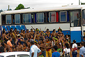 "Altamira, Brazil. ""Xingu Vivo Para Sempre"" protest meeting about the proposed Belo Monte hydroeletric dam and other dams on the Xingu river and its tributaries. Kayapo Indians and a bus."