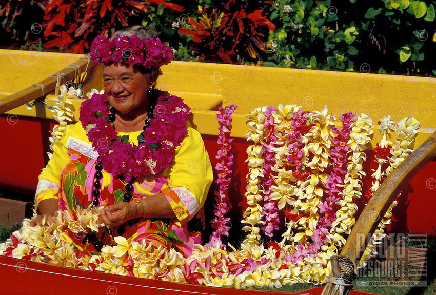 Dancer at Kodak Hula Show with flower leis