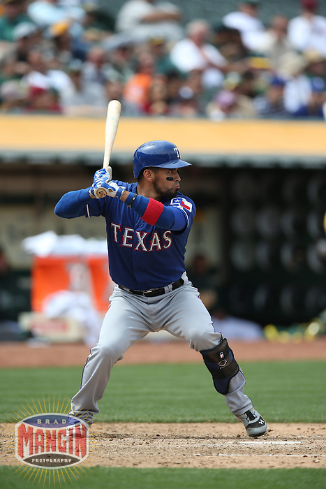 OAKLAND, CA - MAY 15:  Robinson Chirinos #61 of the Texas Rangers bats against the Oakland Athletics during the game at O.co Coliseum on Wednesday May 15, 2013 in Oakland, California. Photo by Brad Mangin