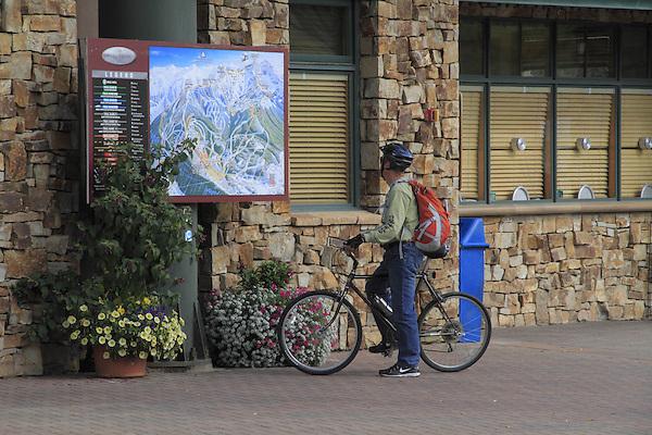 Man with mountain bike at Mountain Village, Telluride Ski Area, Colorado, USA.