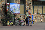 Man with mountain bike at Mountain Village, Telluride Ski Area, Colorado, USA.