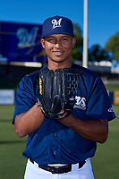 AZL Brewers Blue Yeiner Baez (13) poses for a photo before an Arizona League game against the AZL Athletics Gold on July 2, 2019 at American Family Fields of Phoenix in Phoenix, Arizona. AZL Athletics Gold defeated the AZL Brewers Blue 11-8. (Zachary Lucy/Four Seam Images)