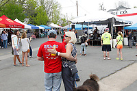 ALTERED STATE PHOTO ESSAY/ANDREW SHURTLEFF<br /> The Fitzgerald's Tire and Auto parking lot is filled with people enjoying the TomTom festival.<br /> <br /> Shut downs and stay-in-place orders, the most recent of which came from Gov. Ralph Northam Monday, have left Charlottesville dormant. Students have been sent home, many businesses have shut their doors and events have been canceled. In this photo essay, photographer Andrew Shurtleff has spent time capturing the effects of the pandemic and comparing the duality of the present with our social past.