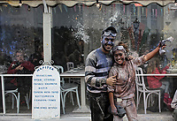 Pictured: A young couple pause for a picture during the flour wars in Galaxidi, Greece. Monday 19 February 2018<br /> Re: Clean Monday (Monday of Lent) celebration of flour wars (Alevromoutzouroma) in the town of Galaxidi, which coincides with the beginning of the Greek Orthodox Lent in Greece. The origins of the custom are unclear, however it appears in its current form since the mid-19th century.<br /> Locals and visitors of all ages gather to collect large quantities of flour which they throw to each other. Various types of coloring is added for effect while people paint their faces with charcoal.