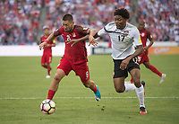 Commerce City, CO - Thursday June 08, 2017: Clint Dempsey, Mekeil Williams during a 2018 FIFA World Cup Qualifying Final Round match between the men's national teams of the United States (USA) and Trinidad and Tobago (TRI) at Dick's Sporting Goods Park.