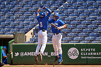 Memphis Tigers Ian Bibiloni (3) is greeted at home by Hunter Goodman (35) after hitting a home run during a game against the East Carolina Pirates on May 25, 2021 at BayCare Ballpark in Clearwater, Florida.  (Mike Janes/Four Seam Images)