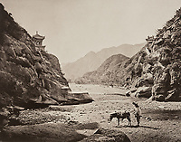 BNPS.co.uk (01202 558833)<br /> Pic: ForumAuctions/BNPS<br /> <br /> Pictured: Thomson captured the stunning landscape at mountainside villages.<br /> <br /> Rarely seen 150 year old photos taken by one of the first British photographers to explore China have emerged for sale for £20,000.<br /> <br /> Scotsman John Thomson (1837-1921) travelled to the Far East in 1868 and established a studio in Hong Kong, using it as a base to explore remote parts of the vast country for the next four years, photographing landmarks, scenery and the native population.<br /> <br /> In many cases, he was the first Westerner the people he photographed had encountered.<br /> <br /> One striking image shows a prisoner in chains with a head poking through a board covered in Chinese symbols, perhaps listing his misdemeanours. In another, a man poses next to a giant camel statue in the grounds around the Ming tombs of the Forbidden City.<br /> <br /> Almost 100 of his photos feature in a rare first edition of 'Thomson Illustrations of China and Its People' (1873), which is going under the hammer with London-based Forum Auctions.
