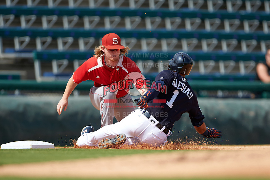 Florida Southern Moccasins third baseman Mitch Reeves (34) tags Jose Iglesias (1) sliding into third base during an exhibition game against the Detroit Tigers on February 29, 2016 at Joker Marchant Stadium in Lakeland, Florida.  Detroit defeated Florida Southern 7-2.  (Mike Janes/Four Seam Images)