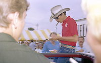 Richard Petty cigar signs autographs at fan event before Firecracker 400 at Daytona International Speedway in Daytona Beach, FL on July 4, 1983. (Photo by Brian Cleary/www.bcpix.com)