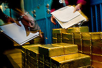 Gold Vault at the New York Federal Reserve at 33 Liberty St. The Federal Reserve Bank of New York - one of the twelve regional capital reserve banks in the capital federal reserve system - is located in the heart of the financial district in downtown Manhattan and holds FIVE percent of the world's gold... at 125,000 tons of gold in the world, that means they must have 6,250 tons...The vault contains international monetary gold and the move of just a few feet between storage closets can shape the balance of financial power between nations.