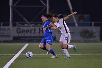 Fleur Pauwels (66) of KRC Genk and Stefania Vatafu (10) of Anderlecht battle for the ball during a female soccer game between  Racing Genk Ladies and Royal Sporting Club Anderlecht , a delayed game from the 1st  matchday of the 2021-2022 season of the Belgian Scooore Womens Super League , tuesday 28 September 2021  in Genk , Belgium . PHOTO SPORTPIX | JILL DELSAUX