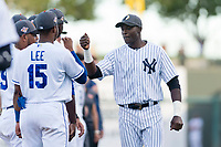 AFL West outfielder Estevan Florial (13), of the Glendale Desert Dogs and New York Yankees organization, fist bumps with teammates, including Khalil Lee (15), during player introductions before the Arizona Fall League Fall Stars game at Surprise Stadium on November 3, 2018 in Surprise, Arizona. The AFL West defeated the AFL East 7-6 . (Zachary Lucy/Four Seam Images)