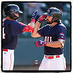 Devlin Granberg (26) of the Greenville Drive is greeted by Tyler Dearden (24) after hitting a home run in a game against the Bowling Green Hot Rods on Thursday, May 6, 2021, at Fluor Field at the West End in Greenville, South Carolina. (Tom Priddy/Four Seam Images)
