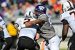 Oklahoma State Cowboys quarterback Mason Rudolph (2) and TCU Horned Frogs defensive end Josh Carraway (94) in action during the game between the Oklahoma State Cowboys and the TCU Horned Frogs at the Amon G. Carter Stadium in Fort Worth, Texas.
