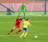 YOKOHAMA, JAPAN - AUGUST 6: Stephanie Labbe #1 of Canada looks to the ball during a game between Canada and Sweden at International Stadium Yokohama on August 6, 2021 in Yokohama, Japan.