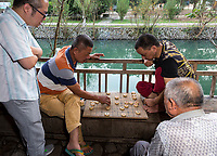 Yantou, Yongjia, Zhejiang, China.  Men Playing Checkers, Lishui Street.