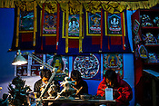 """Local Bhutanese Craftsmen work in a handicrafts store in the capital Thimpu. Bhutanese are extremely conscious of their traditions and heritage. Television and the internet have been accessible only since 1999 in Bhutan, and were introduced despite widespread fears that their """"controversial"""" content such as fashion shows, western music, wrestling, and pornography, could destroy the kingdom's traditional way of life based on unique Buddhist principles. Photo: Sanjit Das/Panos."""