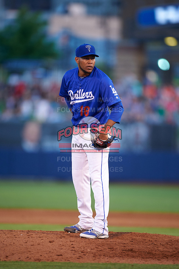 Tulsa Drillers pitcher Jorge De Leon (18) looks in for the sign during a game against the Midland RockHounds on June 2, 2015 at Oneok Field in Tulsa, Oklahoma.  Midland defeated Tulsa 6-5.  (Mike Janes/Four Seam Images)