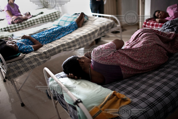Surrogate mothers lie on beds at the Akanksha Infertility and IVF Clinic. The centre has become the most popular clinic in India for outsourcing pregnancies for western couples.