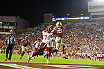 Florida State wide receiver Tamorrion Terry (15) goes up for a touchdown grab as North Carolina State cornerback Chris Ingram (7) defends in the second half of an NCAA college football game in Tallahassee, Fla., Saturday, Sept. 28, 2019. Florida State defeated North Carolina State 31-13.   (AP Photo/Mark Wallheiser)