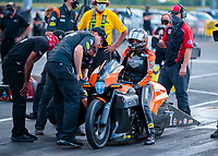 Aug 9, 2020; Clermont, Indiana, USA; Crew members work on the bike of NHRA pro stock motorcycle rider Angelle Sampey during the Indy Nationals at Lucas Oil Raceway. Mandatory Credit: Mark J. Rebilas-USA TODAY Sports