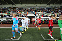 Pictured: The two teams, Swansea led by GerhardbTremmel (L) exit the tunnel. Tuesday 26 August 2014<br /> Re: Capital One Cup, Swansea City FC v Rotherham at the Liberty Stadium, south Wales