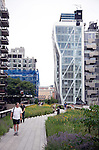 Visitors walk along the High Line which is a public park built on a 1.45-mile-long elevated rail structure running from Gansevoort Street to West 34th Street on Manhattan's West Side, New York City.