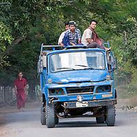 Myanmar, Burma, near Bagan.  Young Burmese Men, Oblivious to Good Safety Rules.