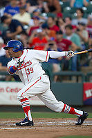 Wearing an Austin Senators throwback uniform, Round Rock Express designated hitter Manny Ramirez (39) delivers a second inning single during the Pacific Coast League baseball game against the Oklahoma City RedHawks on July 9, 2013 at the Dell Diamond in Round Rock, Texas. Round Rock defeated Oklahoma City 11-8. (Andrew Woolley/Four Seam Images)