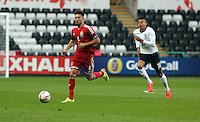 Pictured L-R: Lee Lucas of Wales followed by Jesse Lingard of England. Monday 19 May 2014<br />