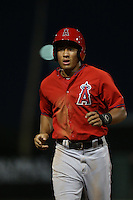 Jahmai Jones (22) of the AZL Angels returns to the dugout during a game against the AZL Giants at Tempe Diablo Stadium on July 6, 2015 in Tempe, Arizona. Angels defeated Giants, 3-1. (Larry Goren/Four Seam Images)