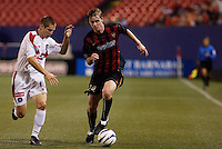 The MetroStars' Eddie Gaven is marked by the Fire's Logan Pause. The Chicago Fire were defeated by the NY/NJ MetroStars 2-1 at Giant's Stadium, East Rutherford, NJ, on July 24, 2004.