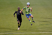 COLUMBUS, OH - DECEMBER 12: Nicolas Lodeiro #10 of Seattle Sounders FC heads the ball in front of Gyasi Zardes #11 of Columbus Crew during a game between Seattle Sounders FC and Columbus Crew at MAPFRE Stadium on December 12, 2020 in Columbus, Ohio.