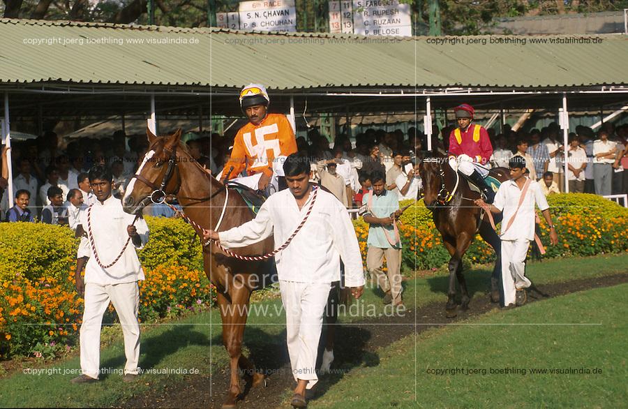 INDIA Mumbai, turf club, horse race course Mahalaxmi in Bombay, jockey with swasthika symbol  / INDIEN, Mumbai Bombay, Pferderennbahn Mahalaxmi
