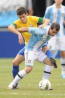 Argentina midfielder Javier Mascherano (14) shields the ball from Brazil midfielder Oscar (10) The Argentina National Team defeated Brazil 4-3 at MetLife Stadium, Saturday July 9 , 2012.