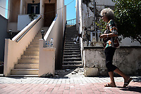 Pictured: A woman walks past a damaged starircase in Kos town, Greece.<br /> Re: A 6.4 Richter Scale earthquake has hit the tourist island of Kos in Greece.