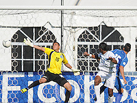 Honduras forward Carlos Costly (13)  heads the ball to score in the 51th minute of the game against El Salvador goalkeeper Benyi Villalobos (18) Honduras National Team defeated El Salvador 3-0 at RFK stadium, Saturday June 2, 2012.