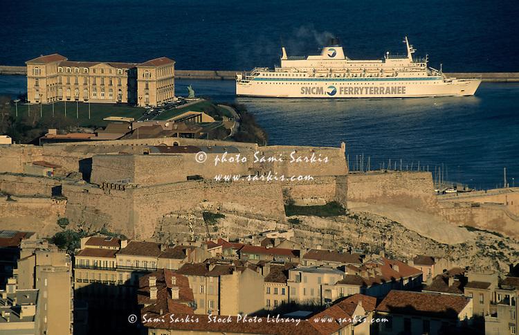 Cruise ship passing the Palais du Pharo and Saint Nicholas fort along the coast of Marseille, France.